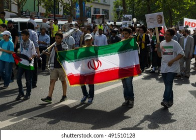 BERLIN, GERMANY - AUGUST 03, 2013: International Quds Day. Demonstrators on the Kurfuerstendamm. Participants with the flag of Iran.