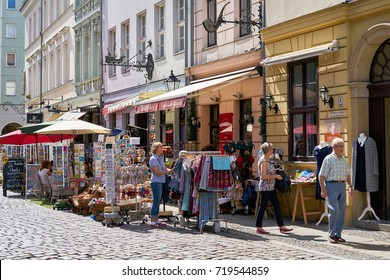 BERLIN, GERMANY – AUGUST 07, 2017: Tourists looking for souvenirs in a shopping street in the Nikolai-Quarter in Berlin-Mitte.