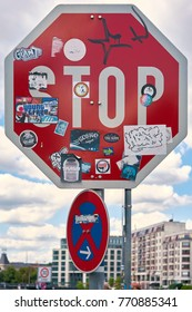 BERLIN, GERMANY – AUGUST 07, 2017: With many stickers stickered stop sign at the roadside in downtown Berlin
