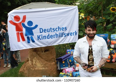 BERLIN, GERMANY - AUGUST 08: Harald Gloeoeckler donates satchels to first Graders at a nursery school at Friedrichshain on August 8, 2012 in Berlin, Germany.