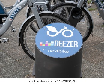 BERLIN, GERMANY - AUGUST 10, 2018: Public Bike Sharing Service Provider: Close-up of A Deezer Nextbike Logo At A Rental Station In Berlin, Germany