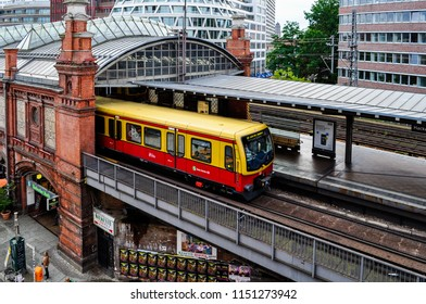 Berlin / Germany — August 12, 2011: an S-Bahn train standing at the platform of Hackescher Markt station. S-Bahn is a rapid transit railway system that complements the Berlin U-Bahn (subway)