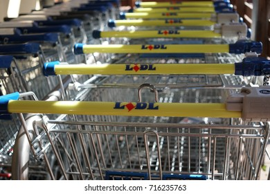 Berlin, Germany - August 12, 2017: line of shopping carts in Lidl supermarket. Lidl is a successful chain of grocery stores