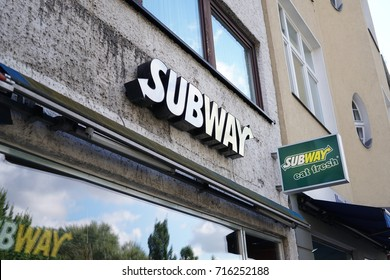 Berlin, Germany - August 12, 2017: Subway fast food restaurant signage. Subway is a privately held American fast food restaurant franchise that primarily sells submarine sandwiches and salads
