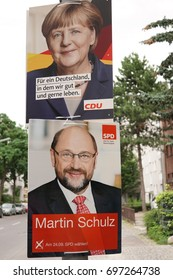 Berlin, Germany - August 13, 2017: Election campaign billboards of German political parties CDU and SPD with the portrait of the leaders Angela Merkel and Martin Schulz