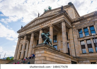 Berlin, Germany - August 13, 2019: Bronze lion and angel statue in front of the Berlin Concert Hall on Gendarmenmarkt in Berlin.