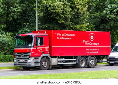 BERLIN, GERMANY - AUGUST 15, 2014: Red truck Mercedes-Benz Actros 2532 in the city street.