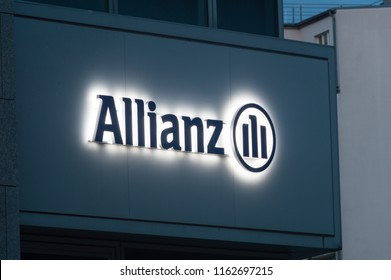 Berlin, Germany - August 15, 2018: Lighted Allianz logo and sign in Berlin. Allianz is a European financial services company headquartered in Munich, Germany.
