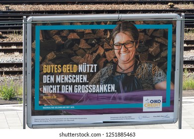 Berlin, Germany - August 15, 2018: German advertising poster of Oikocredit,  a worldwide cooperative and social investor, providing funding to the microfinance sector, fair trade organizations