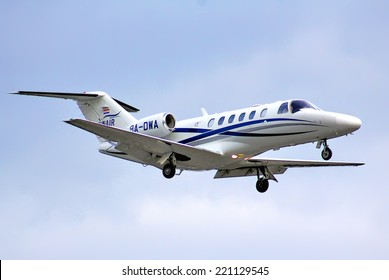 BERLIN, GERMANY - AUGUST 17, 2014: WinAir Cessna 525A Citation arrives at the Tegel International Airport.