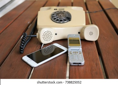 Berlin, Germany - August 18, 2017: comparison between modern iPhone, Philips mobile phone and a retro rotary telephone