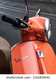 Berlin, Germany - August 19, 2018: Red Vespa scooter. Vespa is an Italian brand of scooter manufactured by Piaggio. The first Vespa was manufactured in the year 1946