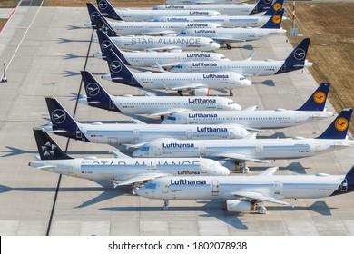 Berlin, Germany - August 19, 2020: Stored Lufthansa airplanes Coronavirus Corona Virus COVID-19 Berlin Brandenburg BER airport aerial view photo in Germany.