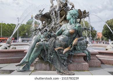 BERLIN, GERMANY - AUGUST 20, 2019: Details of Neptune Fountain (Neptunbrunnen) in Berlin was built in 1891. Fountain depicting Roman god of water - Neptune. 4 women representing main rivers in Prussia