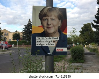 Berlin, Germany - August 21, 2017: Election campaign billboard of German political party CDU. The Christian Democratic Union of Germany is a liberal-conservative political party, centre-right