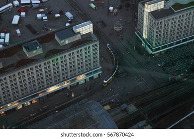 Berlin, Germany - August 22, 2016: Aerial view of capital city on evening seen from television tower central square Alexanderplatz tram turns to station