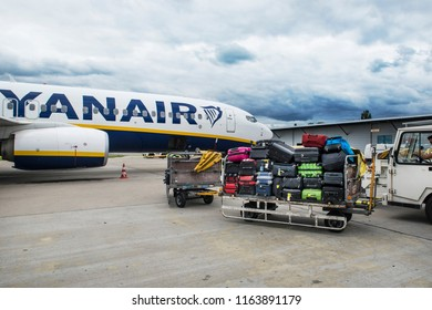 Berlin, Germany - August 22, 2017. Luggage is being loaded to a Ryanair Boeing 737-800 (EI-FRL) as it gets ready for departure at the apron of Berlin Schonefeld Airport.