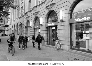 BERLIN, GERMANY - AUGUST 26, 2014: People walk by Miele store in Unter den Linden, Berlin. Miele is a manufacturer of high-end German domestic appliances and was founded in 1899.