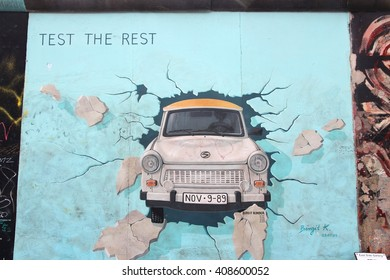 BERLIN, GERMANY - AUGUST 26, 2014: Urban art of East Side Gallery seen from public street in Berlin. Part of former Berlin Wall is covered in art by more than 100 artists since 1990.