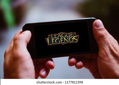 BERLIN, GERMANY - AUGUST 26, 2018: Closeup of smartphone screen with LEAGUE OF LEGENDS GAME LOGO and ICON