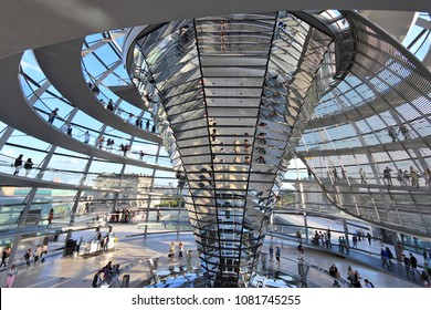 BERLIN, GERMANY - AUGUST 27, 2014: People visit Reichstag building dome in Berlin. The dome was completed in 1999. It was designed by architect Norman Foster.