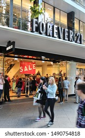 BERLIN, GERMANY - AUGUST 27, 2014: People visit Forever 21 brand clothes store at Tauentzienstrasse in Berlin. There are more than 700 Forever 21 stores worldwide (2015).