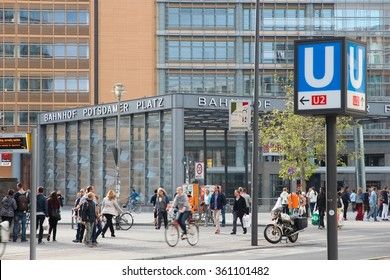 BERLIN, GERMANY - AUGUST 27, 2014: People walk by Potsdamer Platz railway station in Berlin. The station has daily ridership of 80,000.