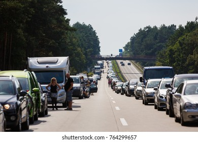 Berlin, Germany - August 28 2016: The long traffic jam on the highway at the exit from Berlin in summer