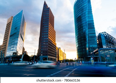 BERLIN, GERMANY - AUGUST 28; Street scenes pedestrians and car blurs below three new ultra-modern architectural high-rise buildings at Potsdamer Platz at dusk August 28, 2017 Berlin Germany
