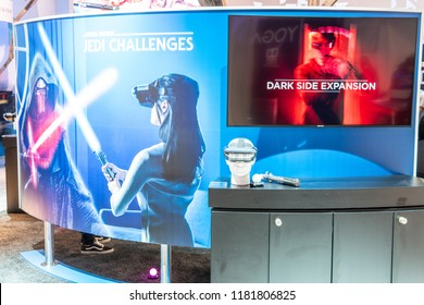 Berlin, Germany, August 29, 2018, Star Wars Jedi Challenges VR game with lightsaber controller, Lenovo Mirage AR headset at exhibition showroom, stand at Global Innovations Show IFA 2018,