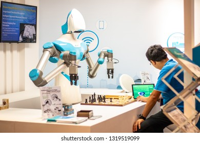 Berlin, Germany, August 29, 2018, ITRI's IVS AI Artificial Intelligence robot humanoid plays a match of chess with an IFA visitor, stand at Global Innovations Show IFA 2018,