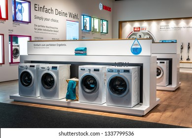 Berlin, Germany, August 29, 2018, Bosch HomeProfessional and Serie8 washing machine tumble dryer on display, at Robert Bosch exhibition pavilion showroom, stand at Global Innovations Show IFA 2018,