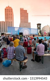 Berlin, Germany - August 29, 2019: International YiXue Art Festival in Potsdamer Platz, event initiated by the Chinese Lotus Grand Master Wei Ling Yi being interviewed