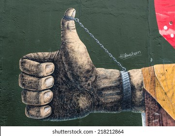 Berlin, Germany - August 30, 2014: East Side Gallery wall of Berlin Germany. Graffiti paintings on the Berlin wall that are part of the East Side Gallery,