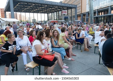 Berlin, Germany - August 31, 2019: Public at the International YiXue Art Festival in Potsdamer Platz, event initiated by the Chinese Lotus Grand Master Wei Ling Yi