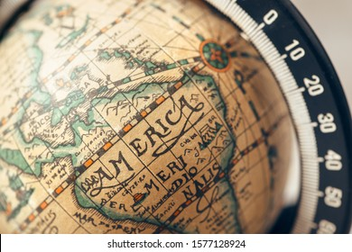 BERLIN, GERMANY - August 31, 2019: Vintage globe closeup, located on America. Concept for travel commercial.