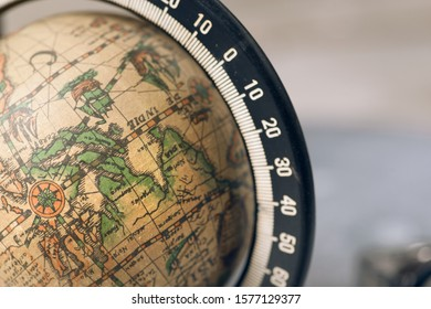BERLIN, GERMANY - August 31, 2019: Vintage globe closeup. Concept for travel commercial.