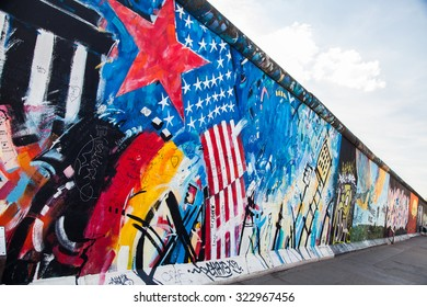 BERLIN, GERMANY - AUGUST 6 2015: Berlin Wall graffiti. The East Side Gallery is an international memorial for freedom. It is a 1.3 km long section of the Berlin Wall located near the centre of Berlin