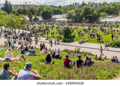 BERLIN, GERMANY - AUGUST 6, 2017: People enjoy Sunday afternoon in Mauerpark park in Berlin.