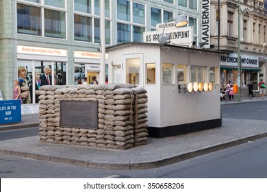 Berlin, Germany - August 7, 2015: Checkpoint Charlie in Berlin, Germany. It was the former border crossing between the West and East Berlin during the Cold War.