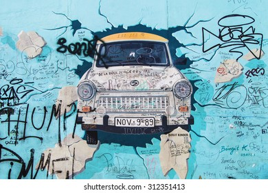 BERLIN, GERMANY - AUGUST 8: Mural 'Test the Rest' by Birgit Kinder on the East Side Gallery, the longest preserved stretch of the wall, on August 8, 2015 in Berlin, Germany.