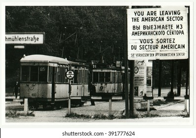 BERLIN, GERMANY - CIRCA 1950s: Vintage photo shows checkpoint between west (American sector) and ost Berlin. Tram leaves American sector.