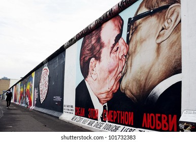 BERLIN, GERMANY - CIRCA DECEMBER 2011 - Part of the East Side Gallery graffiti of the author Dimitry Vrubel representing the kiss between Brezhnev and Honecker on the Berlin Wall. CIRCA DECEMBER 2011.
