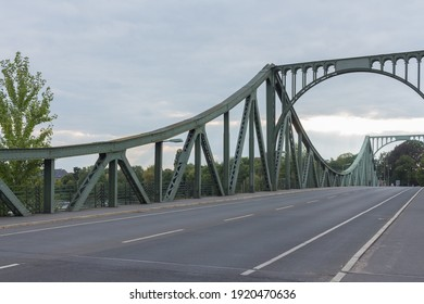 BERLIN, GERMANY - CIRCA JULY, 2018: The Glienicke Bridge (Glienicker Brücke) is a bridge across the Havel River in Germany,  connecting Wannsee district of Berlin with the Brandenburg capital Potsdam.