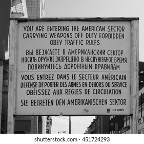 BERLIN, GERMANY - CIRCA JUNE 2016: Checkpoint Charlie (aka Checkpoint C) wall crossing point between East Berlin and West Berlin during the Cold War in black and white