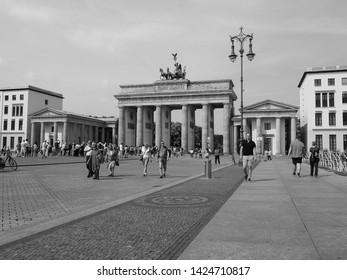 BERLIN, GERMANY - CIRCA JUNE 2019: People at Brandenburger Tor (Brandenburg Gate) in black and white