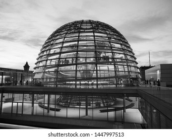 BERLIN, GERMANY - CIRCA JUNE 2019: Dome of the Bundestag German Houses of Parliament at dusk in black and white