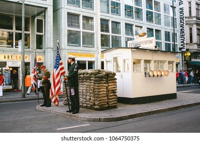 BERLIN, GERMANY - CIRCA SEPTEMBER 2009: Actors for photograph hire at the reconstructed Checkpoint Charlie, the best-known Berlin Wall crossing point between East and West Berlin during the Cold War
