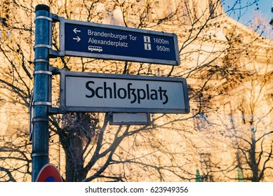 Berlin, Germany - December 02, 2016: Road sign direction to Schlafplatz, alexanderplatz,Brandenburg Gate