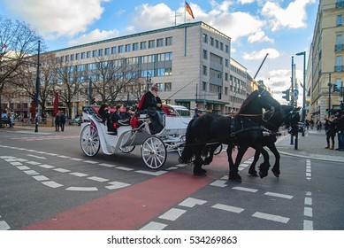 Berlin, Germany - December 02, 2016:White carriage with black horses in Berlin on the street